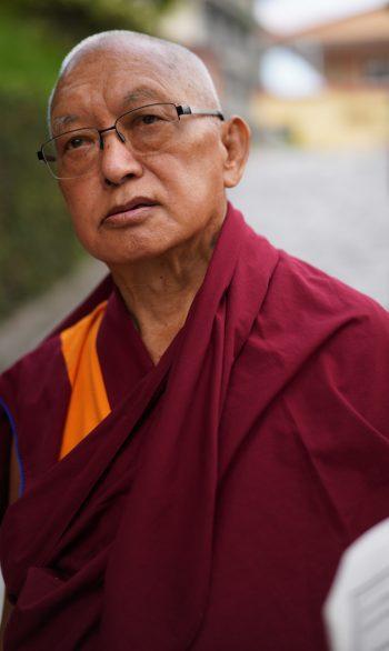 Lama Zopa Rinpoche on a walk around Kopan Monastery looking thoughtful