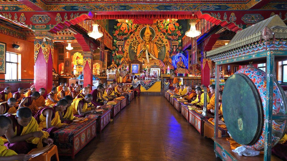 Monks in Kopan gompa doing puja