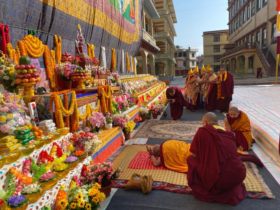 Displaying the Guru Rinpoche Thangka and 100,000 Tsog offerings at Khachoe Ghakyil Ling, Nepal