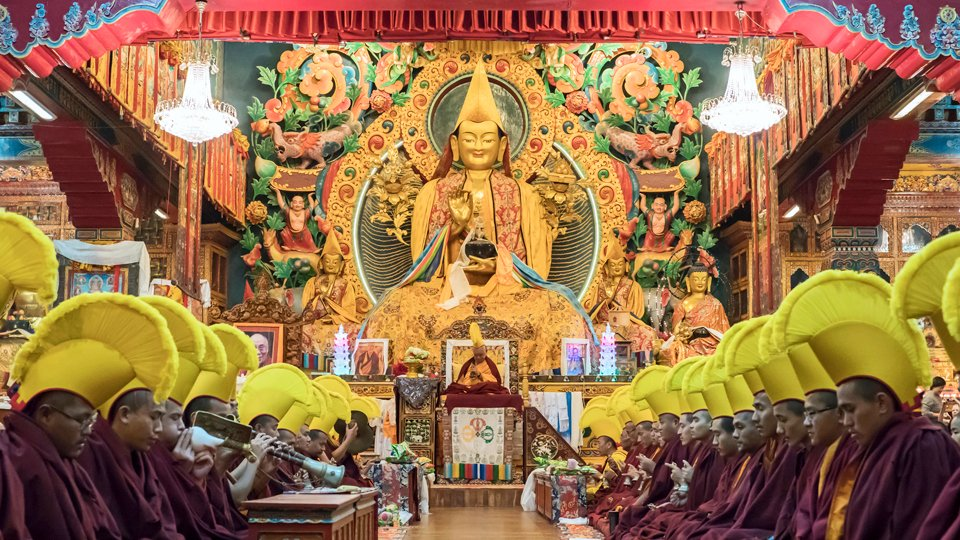 Monks doing puja in front of large statue of Lama Tsongkhapa at Kopan Monastery