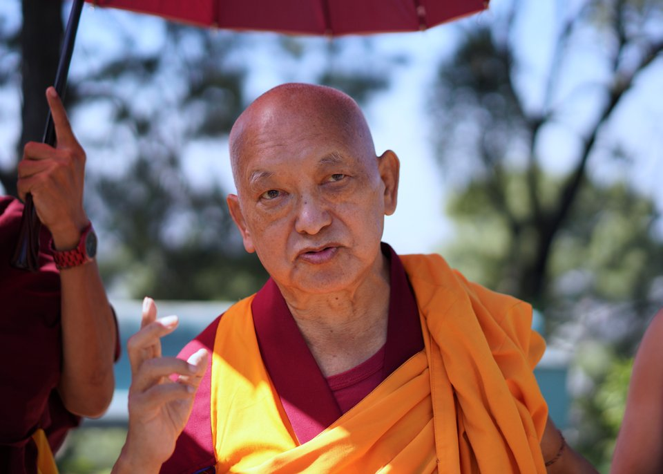 Lama Zopa Rinpoche walking in the garden at Kopan Monastery