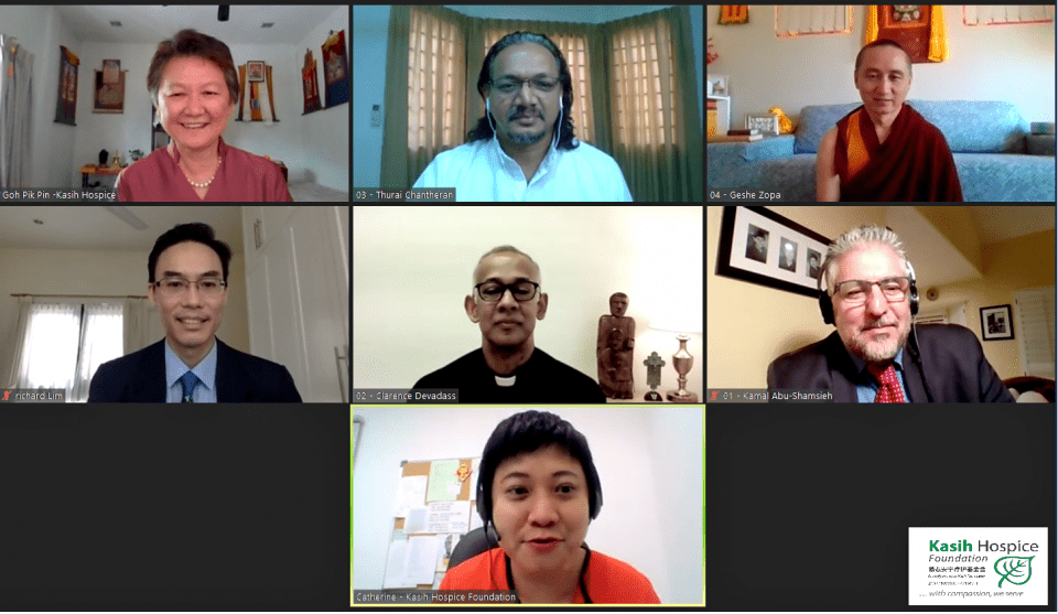 Screenshot of a Zoom meeting with 9 smiling people.