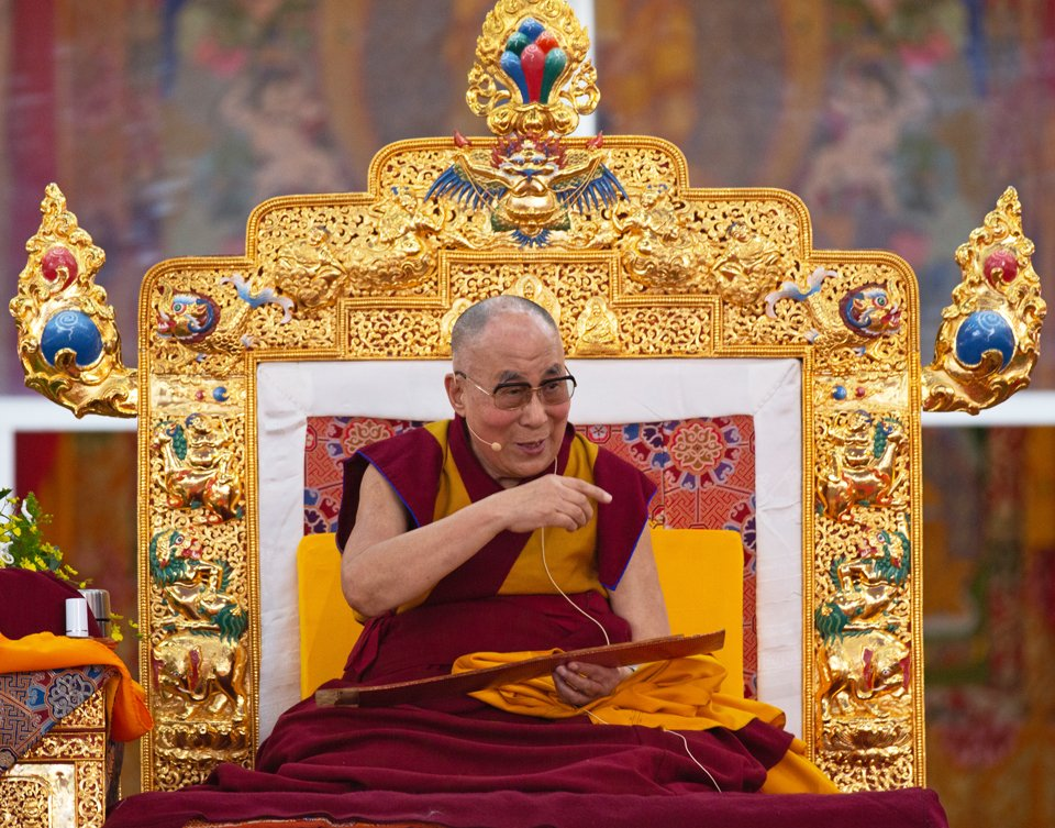 His Holiness the Dalia Lama giving a teaching on his golden decorated throne