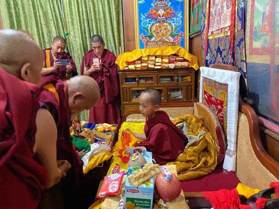 young Trulshik Rinpoche with other monks and Lama Zopa Rinpoche greting him.