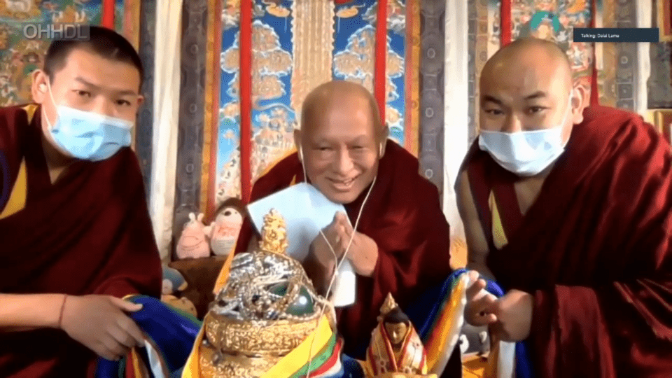 Lama Zopa Rinpoche with Vens. Topgye and Tendar bowing and listening on headphones