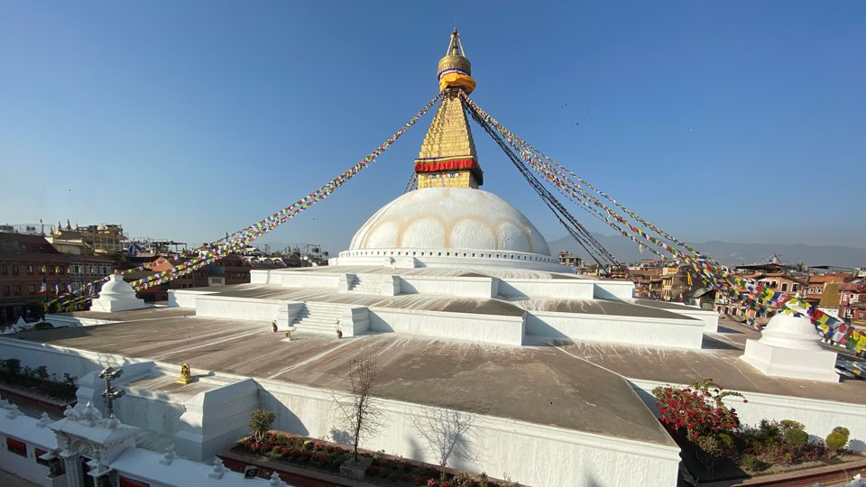 view of Boudha Stupa with builds and hills in the background