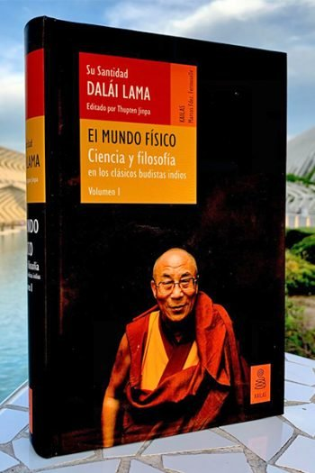 Book with the Dalai Lama on the cover displayed in front of a beautiful landscape scene.
