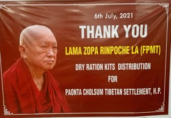 banner with lama zopa rinopche's image on it that says