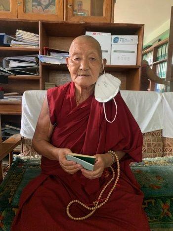 Tibetan monk offering thanks.