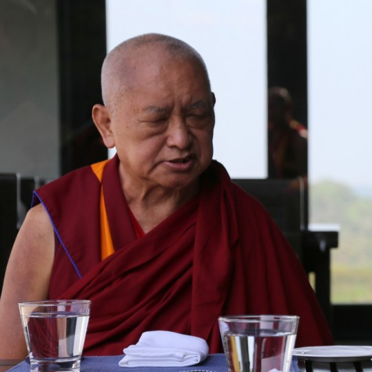 Lama Zopa Rinpoche at a restaurant near Sera Monastery, India, December 2015. Photo by Ven. Thubten Kunsang.