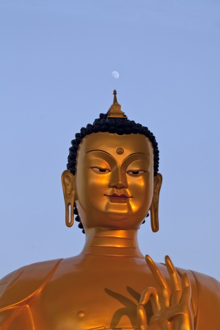 A scale replica of the Maitreya Buddha statue to be built at Kushinagar, India, before the Maiterya Buddha Kushinagar Project foundation stone laying ceremony, December 2013. Photo by Andy Melnic.