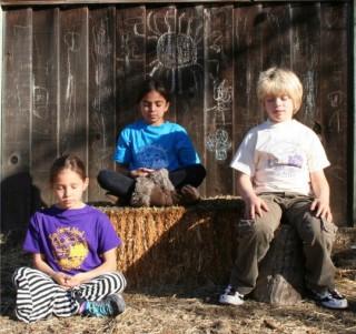 Children practicing mindfulness, Tara Redwood School, Soquel, California, US. Photo courtesy of Tara Redwood School.