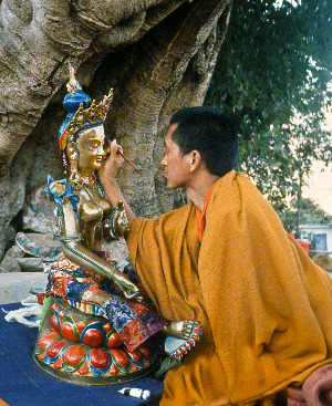 "Lama Zopa Rinpoche ""opens the eyes"" of FPMT's first holy object, Tara statue, Kopan Monastery, 1976."