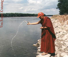 Rinpoche blesses the Platte River, Nebraska, on his way to Osel Shen Phen Ling, August 97
