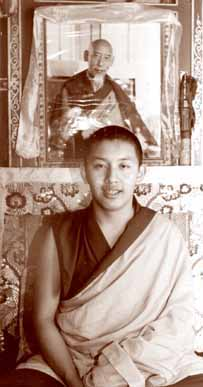 Zong Rinpoche before a picture of his previous incarnation.