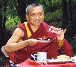 Lama Zopa Rinpoche offering food. Photo by George Propps.
