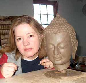 Sculptor Lisa Sofman with the clay prototype for the statue of Kyabje Ling Rinpoche.