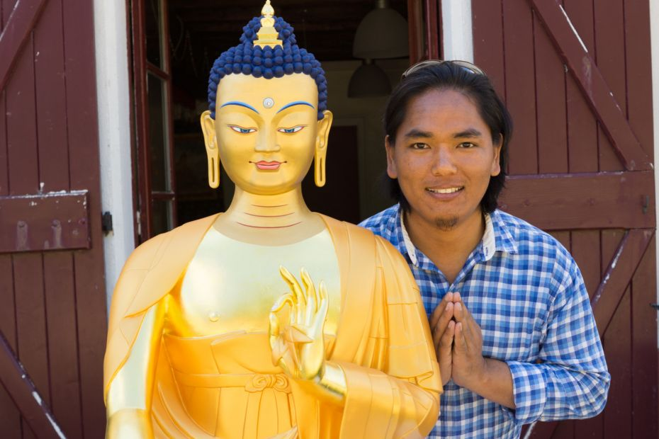 maitreya-buddha-statue-and-the-artist-who-painted-it-sonam-sherpa-at-nalanda-monastery-in-august-2016-photo-by-harald-weichhart