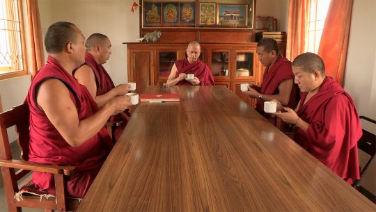 Khen Rinpoche Nicholas Vreeland meeting with monks at Rato Monastery, India. Photo courtesy of Kino Lorber, Inc.