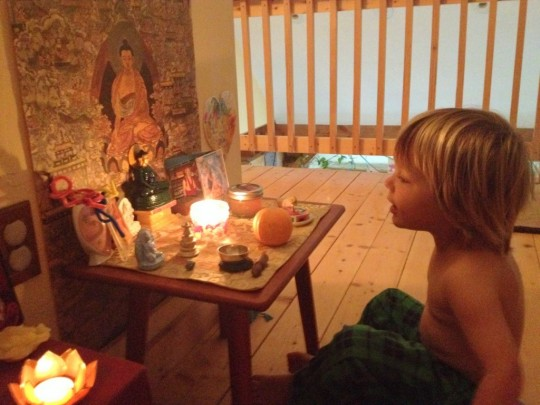 Kasia's son sitting at his altar. Photo courtesy of Kasia Beznoska.