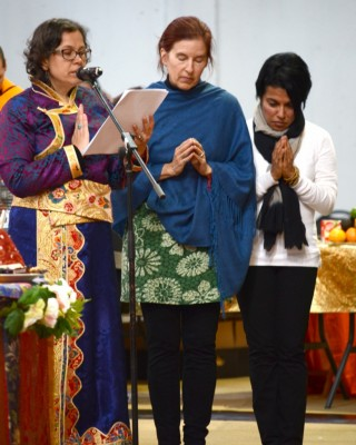 Helen Patrin with Drolkar McCallum and Tara Melwani reads the praises for Lama Zopa Rinpoche offered during the CPMT 2014 long life puja, Australia, September 2014. Photo by Kunchok Gyaltsen.