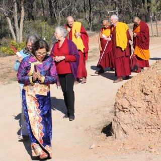Lama Zopa Rinpoche being led to the long life puja in the Great Stupa of Universal Compassion by (from right) Khen Rinpche Geshe Chonyi, FPMT CEO Ven. Roger Kunsang, Thubten Shedrup Ling director Gyatso, FPMT Board of Directors secretary Paula de Wys,  FPMT Australia coordinator Helen Patrin and FPMT Center Cervices director Claire Isitt, Australia, September 19, 2014. Photo by Laura Miller.