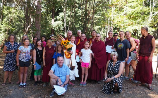 Mia surrounded by family, friends and supporters after completing her goal, Land of Medicine Buddha, August 2015