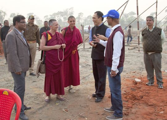 Ven. Trisha and Ven. Samten with District Magistrate Rigzin Samphel visiting the ceremony site as it is being built, Kushinagar, India, December 9, 2013. Photo by Andy Melnic.