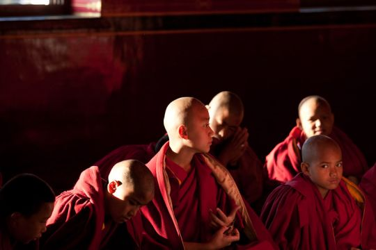 Young monks in the gompa at Kopan Monastery, 2008. Photo by Artis Rams.