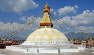 Offerings are made to holy objects, including the Boudhanath Stupa in Nepal