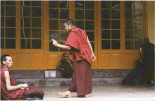 "Monks in Mcleod Ganj sharing the ""free-flowing and love-infused Dharma energy"" in debating situations."
