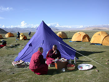 Lama Zopa Rinpoche with fellow Sangha, Tibet, 2002.