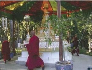 Sangha circumambulating stupa at Kachoe Dechen Ling, Lama Zopa Rinpoche's residence in Aptos, CA
