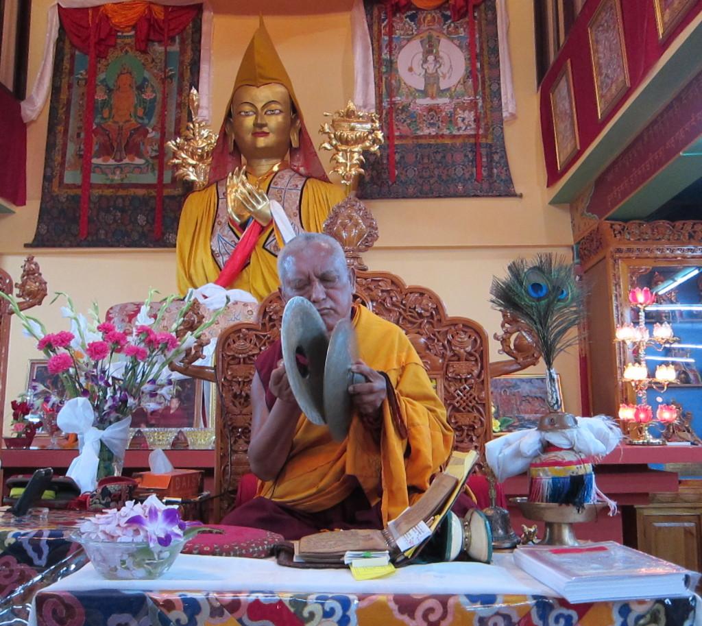 Lama Zopa Rinpoche playing cymbals at Tushita Meditation Centre, India, June 2013. Photo by Ven. Sarah Thresher.