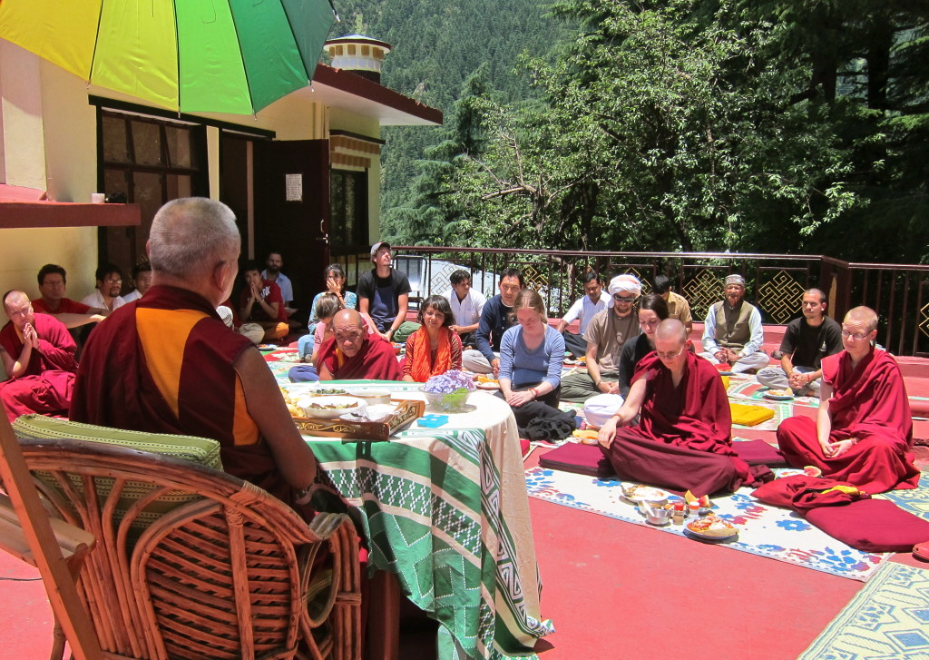 Lama Zopa Rinpoche having lunch with Tushita staff on the roof of the gompa. Tushita. June 18, 2013 Photo by Ven.Sarah Thresher.