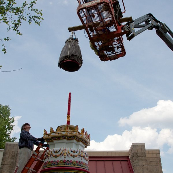 Lowering disk section on top stupa's tree of life, Kadampa Center, U.S., May 2013. Photos courtesy of Kadampa Center.