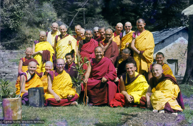 Ordination group with Lama Yeshe, 1976. Front row: George Churinoff (Karin Valham behind him), Elisabeth Drukier, Dieter Kratzer, (Losang Nyima behind him), Lama Yeshe, Thubten Pende (Jim Dougherty), Steve Malasky (Steve Pearl). Gareth Sparham and Marcel Bertels are behind Pende and Steve. Back row (standing): Margret McAndrew, Adrian Feldmann (Thubten Gyatso), Scott Brusso, Ursula Bernis, Wendy Finster, unknown tibetan monk, in back Angeles de la Torre, Jeffery Webster, unknown tibetan monk, Peter Kedge, Roger Wheeler, John Feuille. Photo courtesy of Lama Yeshe Wisdom Archive.