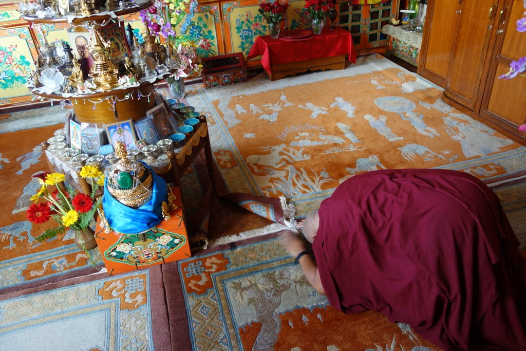 Lama Zopa Rinpoche making prostrations to his altar at Kopan Monastery, August 10, 2013. Photo by Ven. Roger Kunsang.