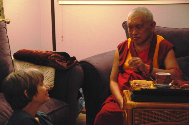 Lama Zopa Rinpoche gives Amy Cayton advice on cat care. Photo courtesy of Amy Cayton.