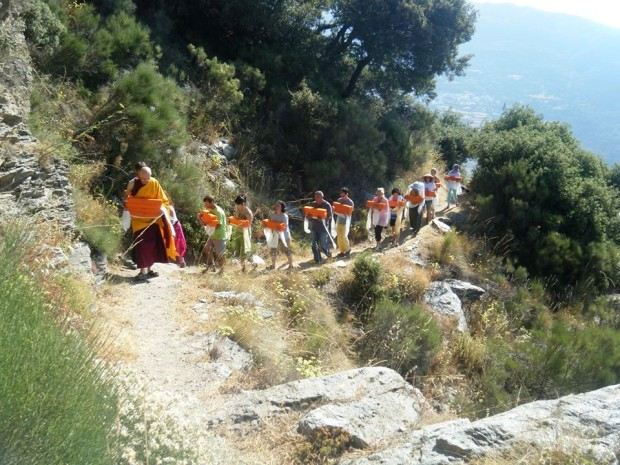 Ven. Jesús Revert (Champa Shenpen) lead the procession of the Kangyur at O.Sel.Ling Centro de Retiros, July 2013. Photo courtesy of Ven. Fabio Poza.