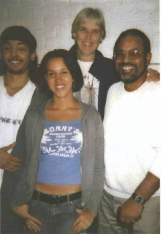 André Smith (right) with his son Daniel, daughter Jessica and wife Gabi.