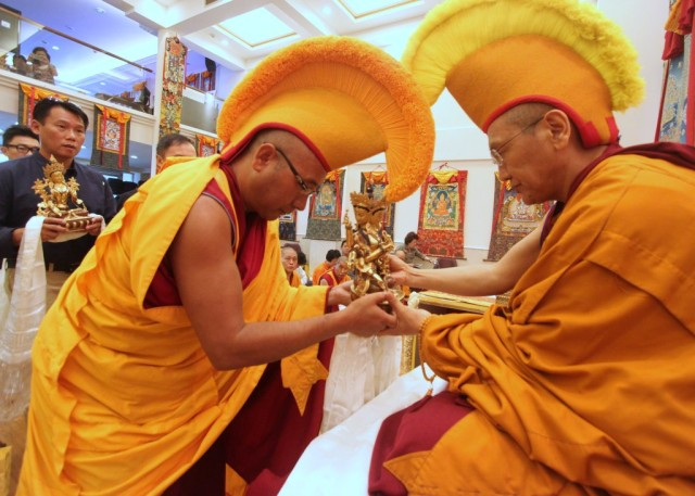 Khen Rinpoche Geshe Chonyi receiving offering from Geshe Sherab at Long Life Puja, Amitabha Buddhist Centre, Singapore, July 2013. Photos courtesy of ABC.