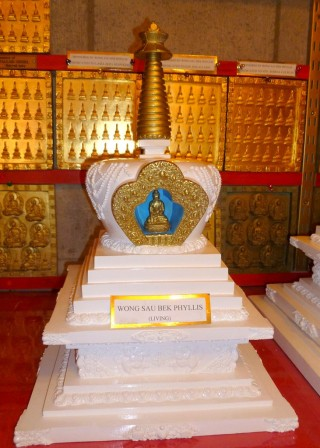 Stupa and wall of tsa-tsa tiles in shrine at Garden of Enlightenment, Queensland. Photo by Ray Furminger.