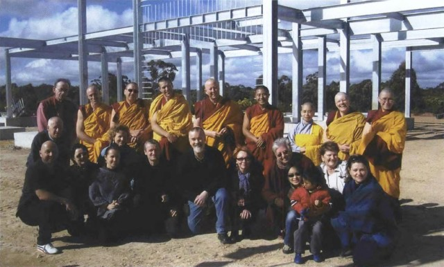 Sangha and students in front of the framework for the Great Stupa.