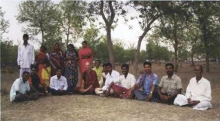 Ven. Kabir, center, with attentive villagers.