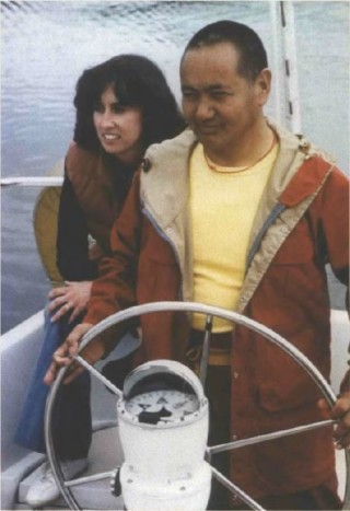 Lama Yeshe with Pam Cowan, sailing in Seattle.