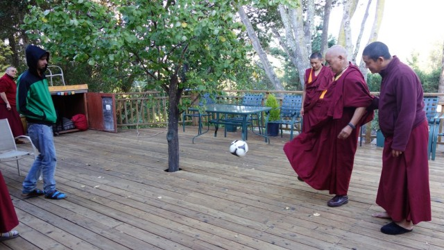 Tenzin Osel Hita and Lama Zopa Rinpoche play a little soccer, Kachoe Dechen Ling, October 7, 2013