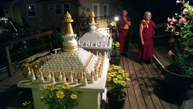 Lama Zopa Rinpoche with Ven. Tsering late at night circumambulating the stupsa in front Kachoe Dechen Ling, September 14, 2013.