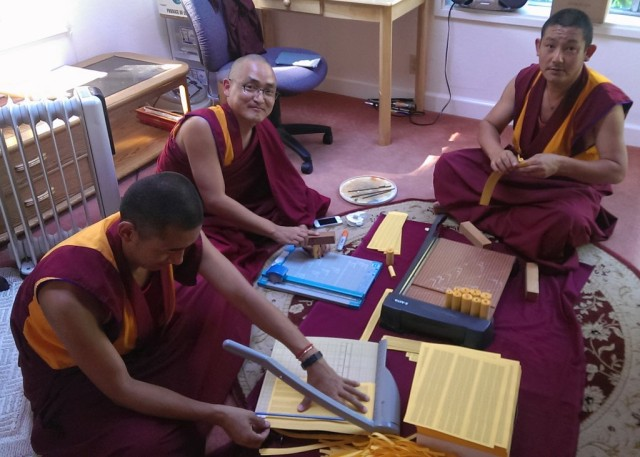 Vens. Sangpo, Sherab and Tsering rolling mantras and filling the statues offered to Rinpoche at the long life puja last week, Kachoe Dechen Ling, October 5, 2013