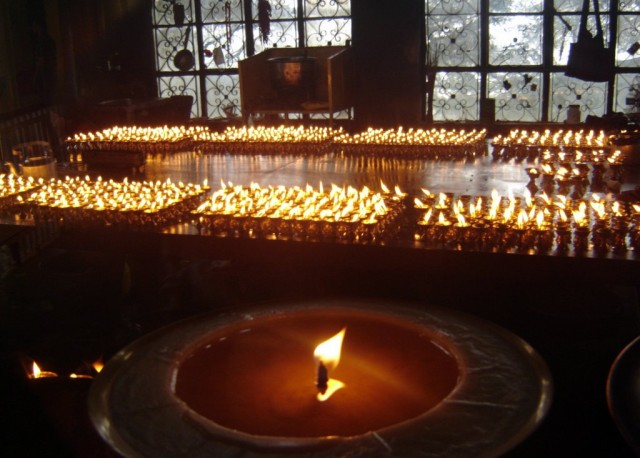 Butter lamps in the darkness, Dharamsala, India. Photo by Himalaya/Dreamstime.